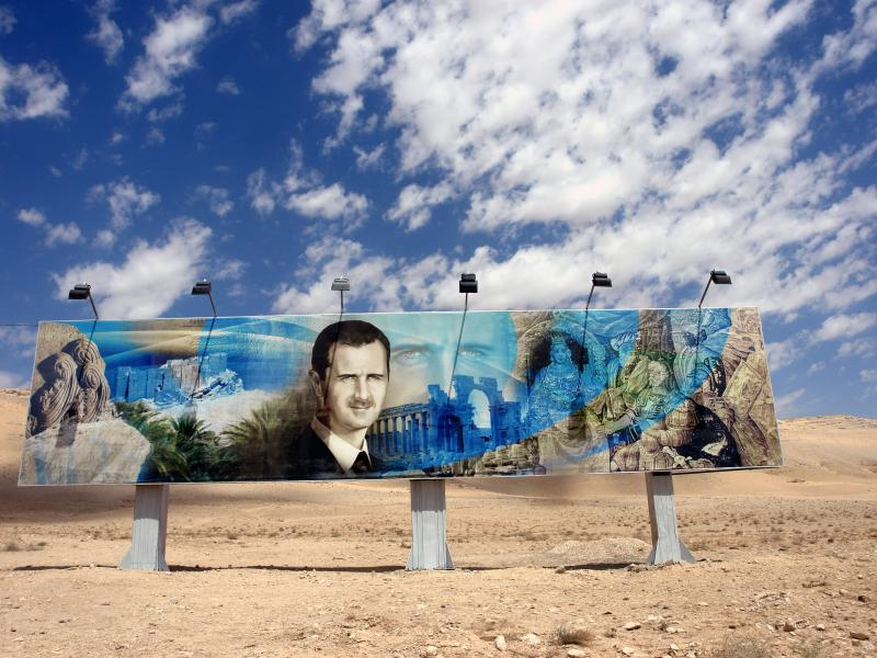 Roadside mural of bashar al assad along the damascus-aleppo highway